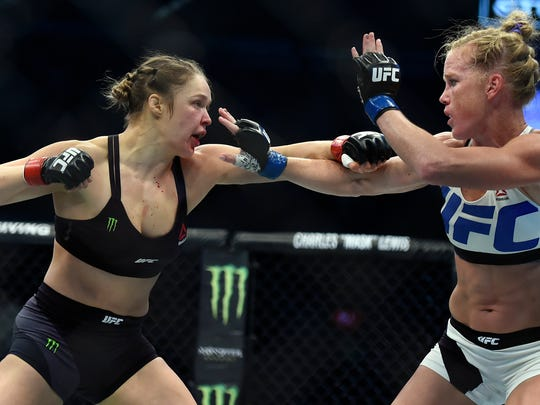 Ronda Rousey, left, and Holly Holm fight during their UFC 193 bantamweight title bout in Melbourne, Australia, Sunday, Nov. 15. Holm pulled off a stunning upset victory over Rousey in the fight, knocking out the women's bantamweight champion in the second round with a powerful kick to the head.