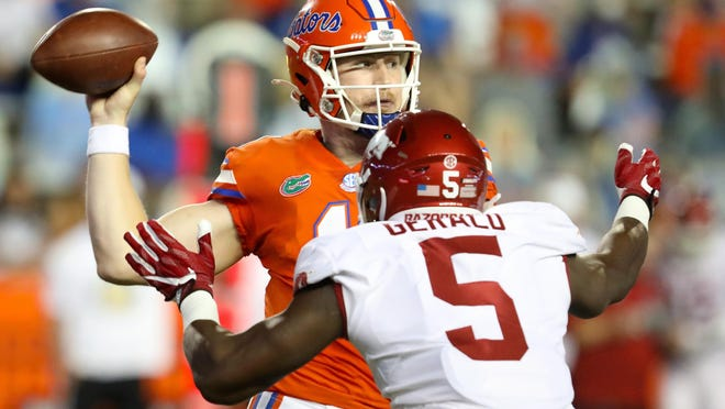 Florida quarterback Kyle Trask (11) looks to throw the ball in the first half against Arkansas at Ben Hill Griffin Stadium.