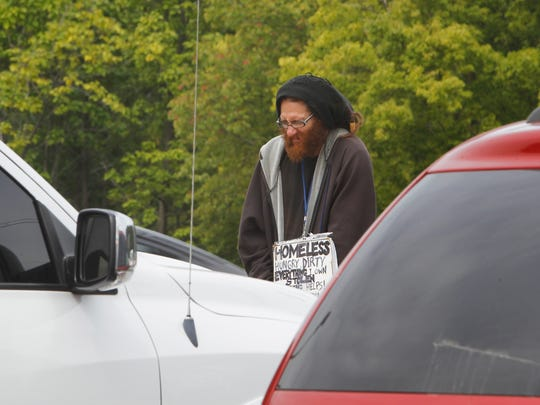 This man, who says he's Brandon Phelps, routinely stands at the entrance to Meijer in Lafayette soliciting donations. It's all legal. But police and homeless advocates encourage people not to give these solicitors money. Instead, donate money to charities that help the homeless.