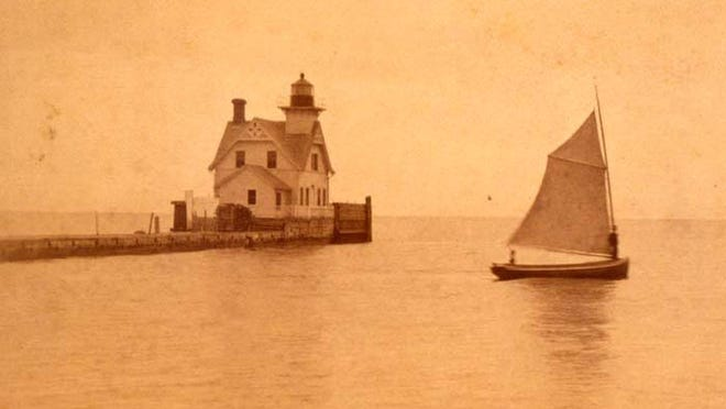 Photo shows a view of the Monroe Lighthouse from the shoreline, circa 1900.The third and final lighthouse at Monroe was created in the exact location of its predecessor in 1885. A new one-and-a-half story dwelling was built with a four gabled design.