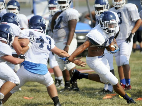 Darius Johnson, right, runs the ball against Colton Glunt for Chambersburg during the first day of football practice on Monday. Trojan coach Mark Saunders said Day 1 was an energetic practice.