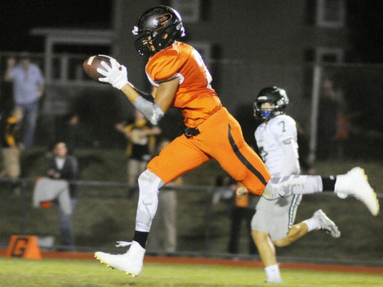 Palmyra's Mason Cooper catches the ball before running for a touchdown during the Cougars' 49-23 win over Trinity on Friday.
