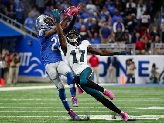 Lions cornerback Darius Slay intercepts a pass intended for Philadelphia Eagles receiver Nelson Agholor late in the fourth quarter Sunday, Oct. 9, 2016 at Ford Field.