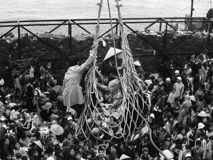 In this April 1, 1975, file photo, a cargo net lifts