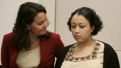 Defense attorney Wendy Tucker, left, speaks with Cyntoia