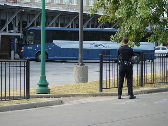 Jackson police officers search a Greyhound bus for a suspect sought in the fatal shooting of a Shreveport, La. officer.