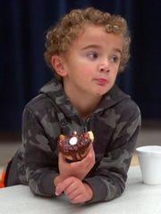 Five-year-old Desmond Walgren enjoys a doughnut.