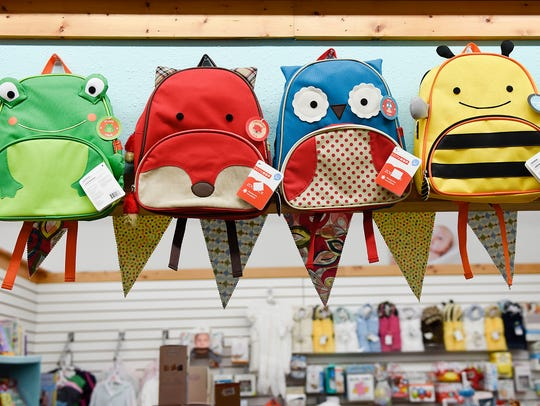 A collection of fun backpacks at Baby's on Broadway