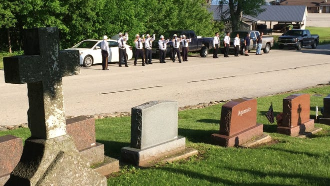American Legion firing squad salutes at St. Louis Cemetery in Dyckesville on Monday, one of nearly two dozen Memorial Day stops by Post 262.
