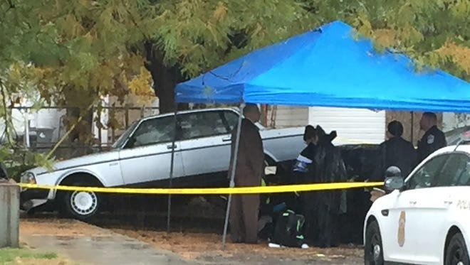 Officers found a woman's body in a car in the 1200 block of South Senate Avenue about 8:20 a.m..