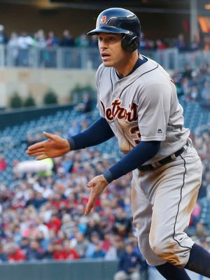 Tigers second baseman Ian Kinsler scores on a hit by J.D. Martinez off Twins pitcher Phil Hughes in the first inning Friday in Minneapolis.
