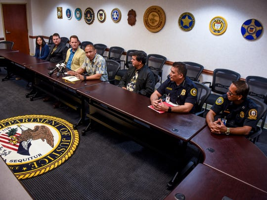 Kevin Rho, center, U.S. Postal Inspection Service assistant inspector in charge, talks about the joint effort between federal and local law enforcement agencies in battling the trafficking of drugs via the U.S. Postal Service into Guam and the Commonwealth Northern Mariana Islands, during a press conference in Hagåtña on Wednesday, Oct. 25, 2017.