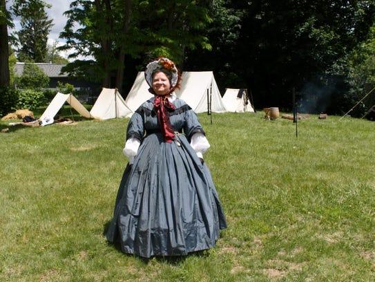 Darlene Lum stands in the Union camp Sunday in Lexington.