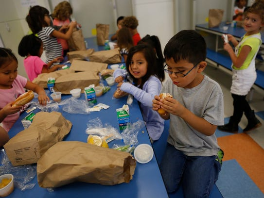 McKinley Elementary School students eat dinner Tuesday