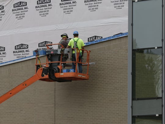 Work on the Oshkosh Arena nears completion Thursday, Oct. 12, 2017, on South Main Street. The sports and entertainment venue is set to open sometime in early November in time for the opening of the inaugural season of the Wisconsin Herd basketball team.