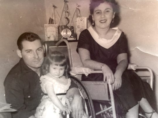 The Stapletons with their first child, from left, Leo holding daughter Deborah, and Violet.