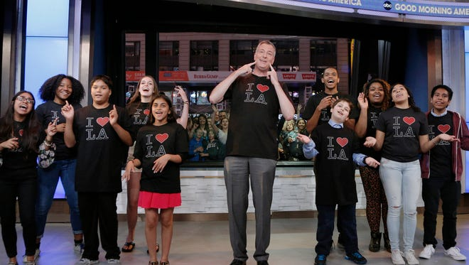 In this photo provided by the American Broadcasting Co., New York Mayor Bill de Blasio, center, appears on the Jimmy Kimmel Live show, Monday, June 16, 2014, in New York.