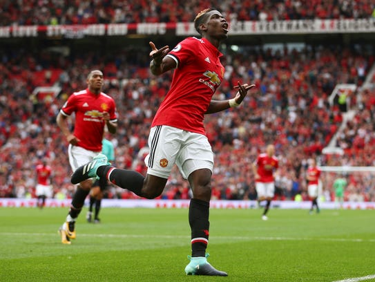Manchester United midfielder Paul Pogba looks to lead
