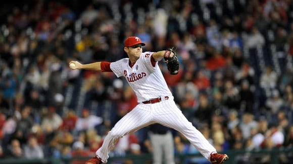 Philadelphia Phillies' Justin De Fratus is seen during a baseball game against the Milwaukee Brewers on Thursday, April 10, 2014, in Philadelphia. (AP Photo/Michael Perez)