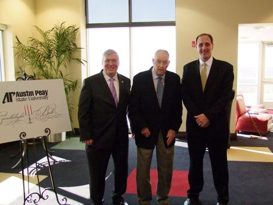 Austin Peay State University President Tim Hall, left, presented the Wendell H. Gilbert Award to George Fisher, center, in February 2013. Fisher died Saturday at age 90. David Loos Jr. is shown at right.