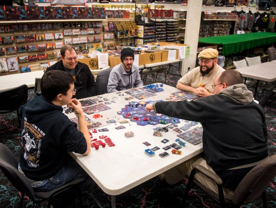 Customers play the board game Twilight Imperium at