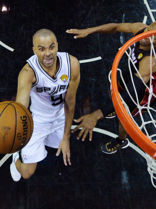 San Antonio Spurs guard Tony Parker (9) shoots against Miami Heat guard Ray Allen during the second half in Game 5 of the NBA basketball finals on Sunday, June 15, 2014, in San Antonio. (AP Photo/Bob Donnan, pool)