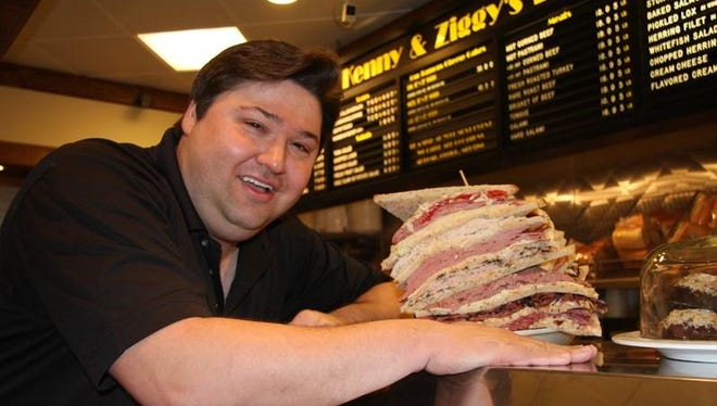 """Ziggy Gruber, a third-generation deli owner, shows off a towering sandwich in """"Deli Man."""""""