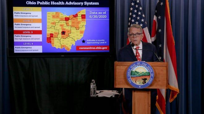 Ohio Gov. Mike DeWine unveils a new county-by-county coronavirus advisory system on July 2, 2020.