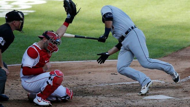 Detroit Tigers catcher Austin Romine (7) dives away from a high-inside pitch in the fourth inning of the Major League Baseball interleague game between the Cincinnati Reds and the Detroit Tigers at Great American Ball Park in Cincinnati on Saturday, July 25, 2020.