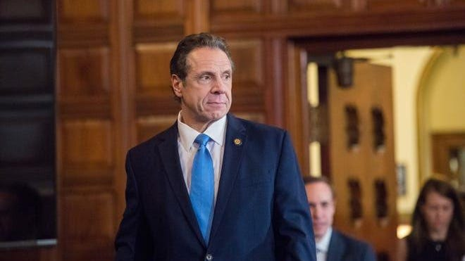 Gov. Andrew Cuomo enters the Red Room at the state Capitol on March 15 to give a daily briefing on the spread of coronavirus.