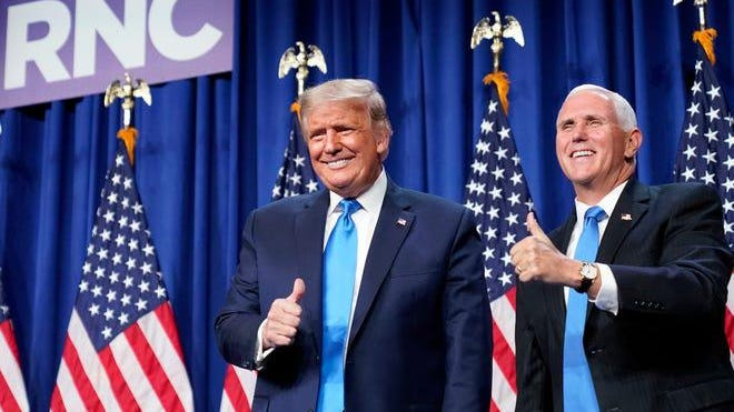 President Donald Trump and Vice President Mike Pence give a thumbs-up after speaking on the first day of the Republican National Convention at the Charlotte Convention Center on August 24, 2020, in Charlotte, North Carolina.