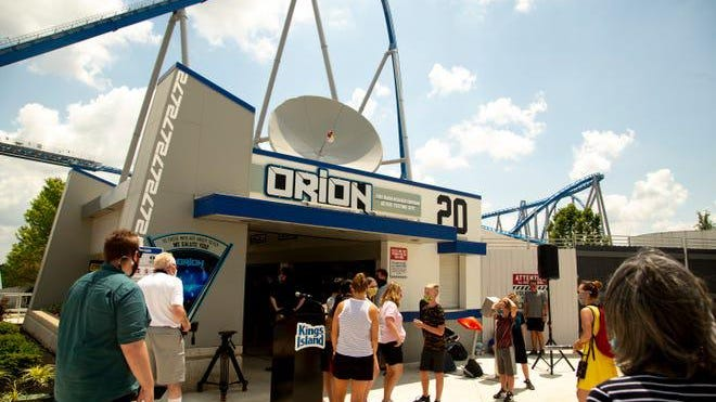 """People filter through the entrance to Kings Island's new rollercoaster """"Orion"""" on Wednesday."""