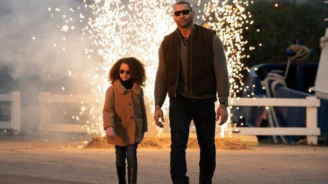 """Sophie (Chloe Coleman) and JJ  (Dave Bautista) try to look as cool as they can in the actio comedy """"My Spy."""" Amazon]"""