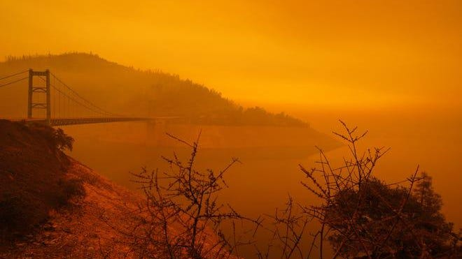 A smoky, orange hue caused by the Bear Fire is seen over Lake Oroville, California on Wednesday afternoon