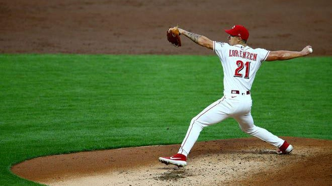 Cincinnati Reds pitcher Michael Lorenzen (21) delivers in the third inning of a Major League Baseball game against the Pittsburgh Pirates at Great American Ball Park in Cincinnati on Tuesday night, Sept. 15, 2020.