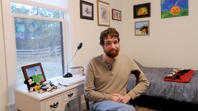 Patrick Ohman has moved into his new unit at FORWARD at the Rock, a Dennis complex that provides housing for young adults with autism or related disabilities. His mother, Kathy, was one of the driving forces behind the project.