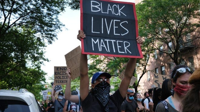 Protesters march on June 15 in New York City after the death of George Floyd while in police custody in Minneapolis.
