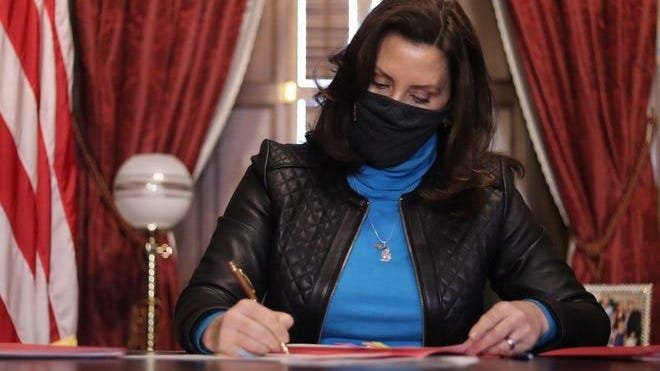 Governor Gretchen Whitmer signs a biparisan relief bill Tuesday, Dec. 29, 2020, the Michigan Legislature passed after she urged them to provide support for Michigan families, frontline workers, and small businesses.