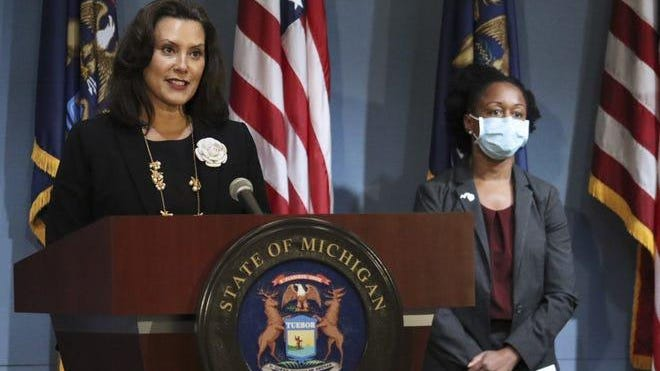 Gov. Gretchen Whitmer appears at a press briefing on Aug. 25, 2020.