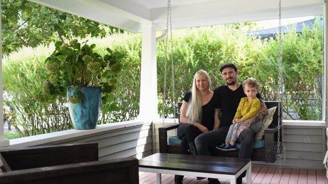 Sara and Ethan Durner, with 3-year-old son Casper, on the front porch of their Lansing home on Saturday, Sept. 26, 2020. After learning their son had a small amount of lead in his system, they signed up for Lansing's lead-abatement program. Their home is now lead-safe.