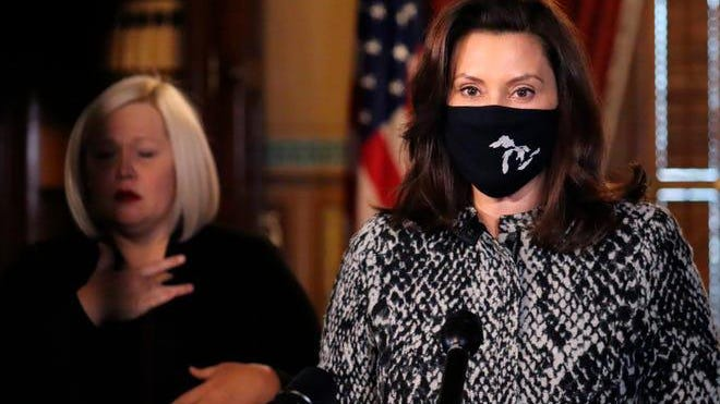 In a photo provided by the Michigan Office of the Governor, Gov. Gretchen Whitmer addresses the state during a speech in Lansing, Mich., Friday, Dec. 18, 2020.