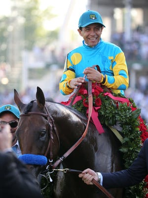 Victor Espinoza aboard American Pharoah celebrates winning the 141st Kentucky Derby at Churchill Downs.