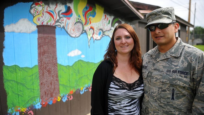 Nikki Emerson and Anthony Davalos will hold a community wedding at Black Eagle Park on Sept. 13. They stand in front of a mural painted by Anthony's son, Kristian, during the couple's community service efforts at Black Eagle Park.