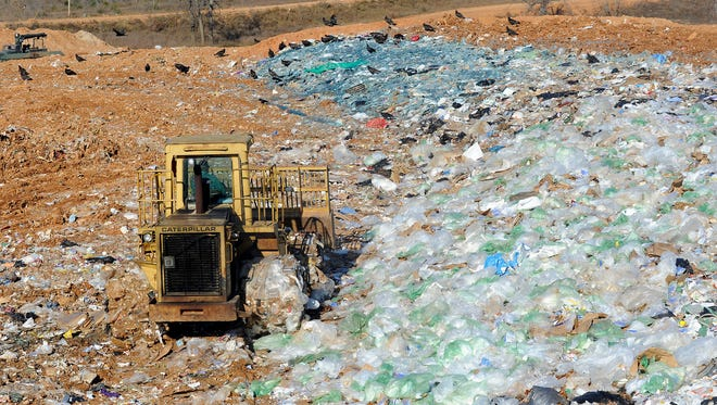 A bulldozer works at the defunct NABORS landfill in 2015. The Arkansas Department of Environmental Quality is taking bids to close landfill