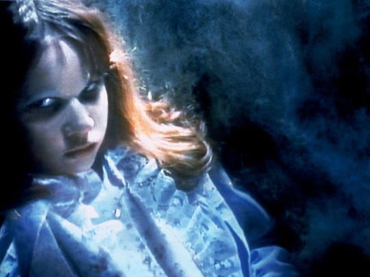 "Linda Blair portrays a possessed Regan MacNeil in a scene from, ""The Exorcist."" Dick Smith created the makeup that transformed the apple-cheeked Blair into a demonic beast."