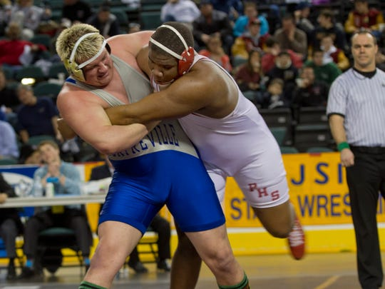 Sayreville's Anthony Porcaro tries to throw Paulsboro's Davontae Ranall who he beat NJSIAA St3-1 at Wrestling Championships  Consolation Round on March 8, 2015 in Atlantic City, NJ.