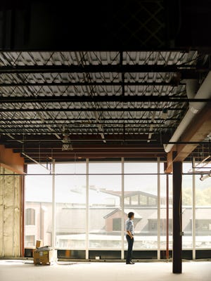 Fred Rainaldi, Jr., stands in a new space under development at the Culver Road Armory.