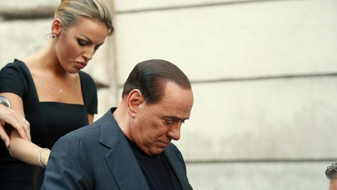 Former Italian Prime Minister Silvio Berlusconi and his girlfriend Francesca Pascale seen in Rome in August.