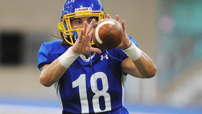 SDSU's Connor Landberg (18) catches a pass while participating in a drill during practice Monday, Aug. 10, 2015, at the Sanford-Jackrabbit Athletic Complex on the SDSU campus in Brookings. S.D.