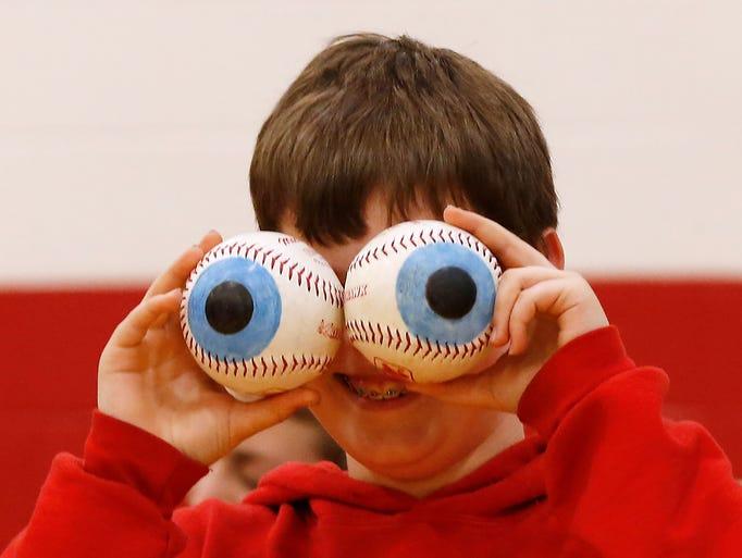 Caleb Milligan demonstrates how big human eyes would